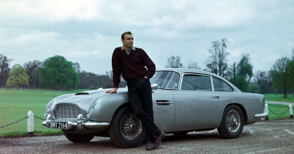 sean-connery-as-james-bond-007-with-aston-martin-db5-goldfinger-set-1200x630-c-ar1.91